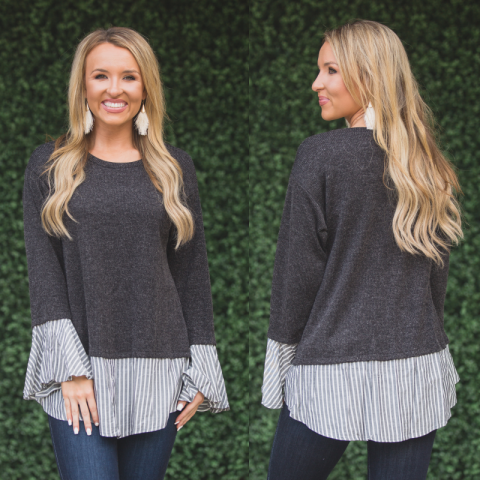 Black ribbed sweater with striped underlay