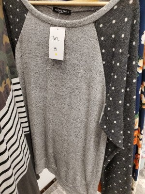 Grey sweater with polka dot sleeves