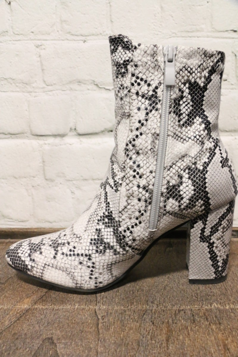Be The Light Snakeskin Booties In White