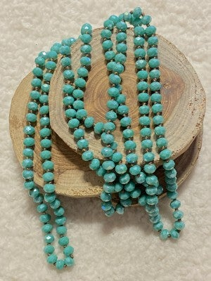 Point Of Perfection Beaded Necklace in Turquoise With Brown Thread
