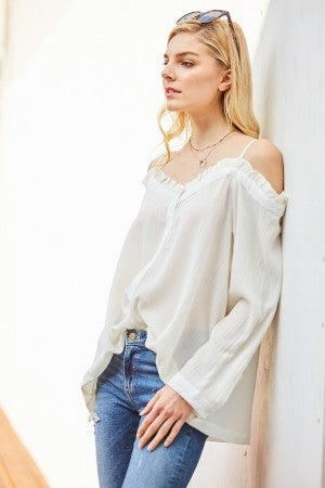 Off-shoulder button-up top featuring ruffle details