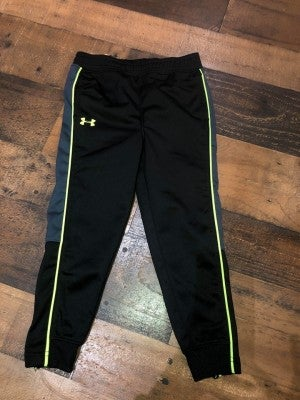 black underarmor joggers with green lining