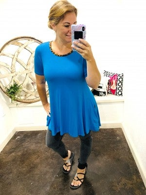 DAILY DEAL Short Sleeve Turquiose Tunic with Leopard Lined Pockets and Leopard Neckline