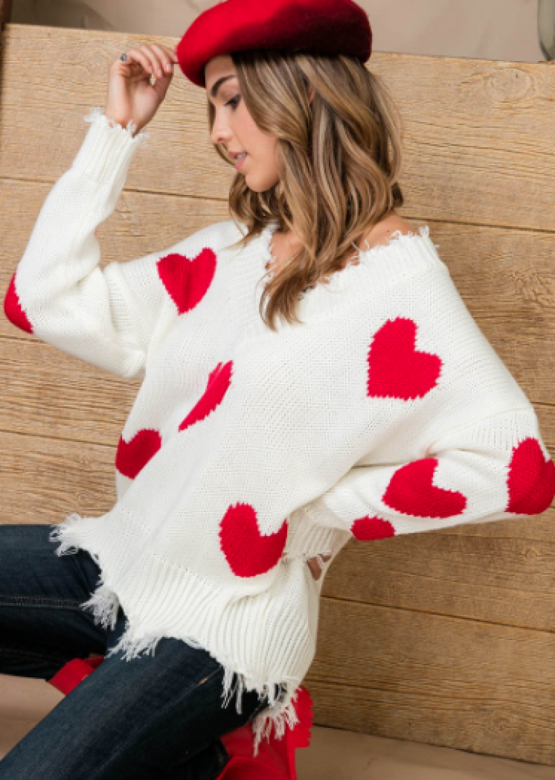 Red heart print distressed v neck long sleeve sweater