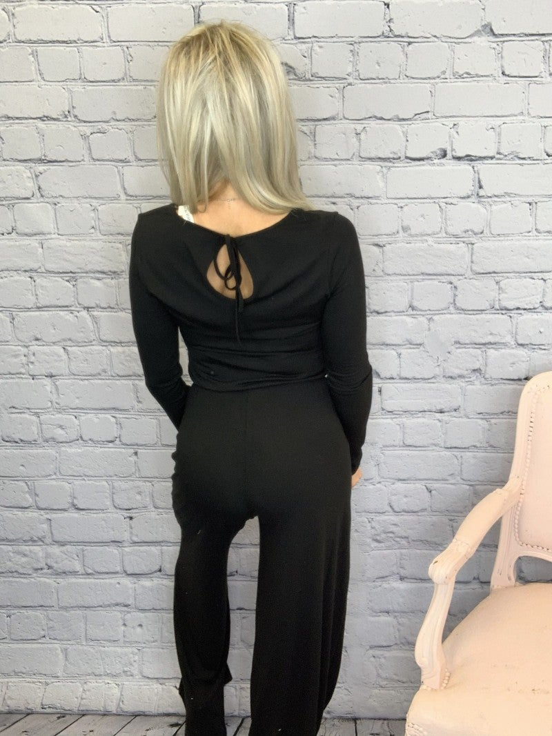 Long sleeve jumpsuit with elastic waist and back keyhole opening