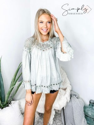 POL- Eyes on the ruffles top featuring lace contrast